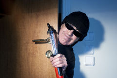 Thief in a house Royalty Free Stock Photos