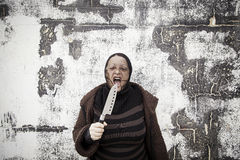 Thief with knife Royalty Free Stock Photography