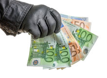 Thief with leather glove is grabbing some bills royalty free stock images