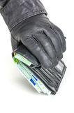 Thief with leather gloves is reaching for a wallet Royalty Free Stock Photos