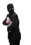 Thief Looking Over Shoulder. A thief holding a laptop is getting paranoid and looking over his shoulder, isolated against a white background Royalty Free Stock Image
