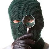 Thief with magnifier Royalty Free Stock Photography