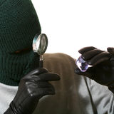 Thief with magnifier and jewel Royalty Free Stock Photo