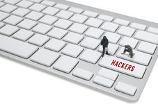Thief man miniature figure concept steal data on keyboard Stock Images