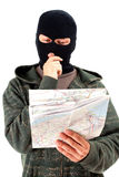 Thief  with map Stock Photo