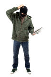 Thief with map Royalty Free Stock Photo