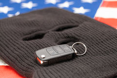 Thief mask with car keys over US flag - studio shot Royalty Free Stock Image