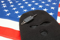 Thief mask with car keys over US flag Royalty Free Stock Photos