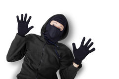 Thief with mask caught and surrender. Closeup of male burglar wearing black mask and jacket, shot in studio with expression of caught and surrender stock image