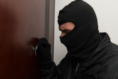 Thief In The Mask Covers Peep Hole Royalty Free Stock Photo