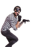 A thief with mask quietly slinking. A thief with mask quietly sneaking. Portrait isolated on white background Stock Photography