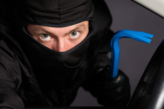 Thief with mask and tool Stock Image