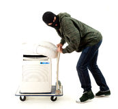Thief with mobile air conditioner Stock Photos