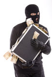 Thief with money Royalty Free Stock Photos