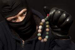 Thief with a necklace Stock Photos