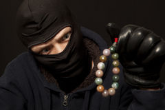 Thief with a necklace Stock Photo