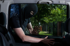 Thief open car lock Stock Photos