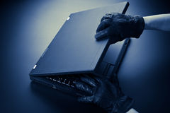 Thief Opening a Computer Royalty Free Stock Image