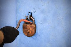 The thief opens the old lock. Stock Photos