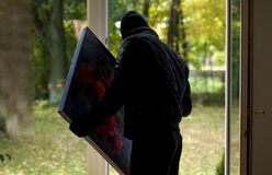 Thief with painting Royalty Free Stock Image