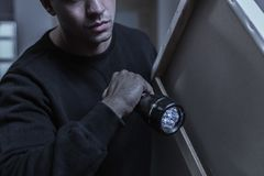 Thief with painting. Horizontal view of male thief with painting royalty free stock photo