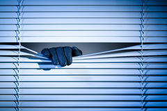 Thief Peeking Through a Window at Night Royalty Free Stock Photography