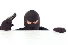 Thief with a pistol. Thief capped with a pistol and the white bottom Royalty Free Stock Photo