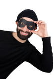 Thief popping out from one side stock photo