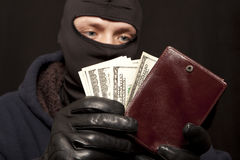 Thief with a purse Stock Photography