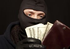 Thief with a purse. A thief sealing from a brown leather purse royalty free stock images