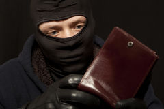 Thief with a purse Royalty Free Stock Photos