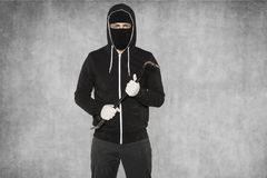 Thief ready to work, gloves, crowbar and balaclava stock images