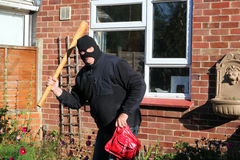 Thief or robber with a weapon. Stock Images