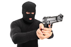 A thief with robbery mask holding a gun Stock Images