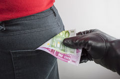 Thief robbing euros Stock Photos