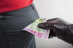 Thief robbing euros Stock Photos