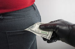 Thief robbing us dollars Royalty Free Stock Photos