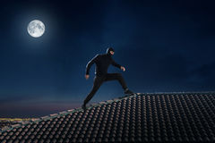 Thief on the roof Royalty Free Stock Images
