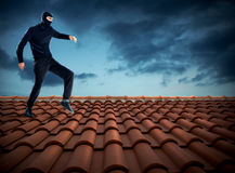 Thief on the roof Stock Image