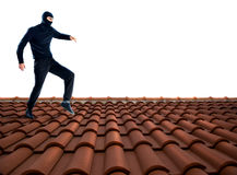 Thief on the roof Stock Photo