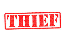 THIEF. Rubber Stamp over a white background Stock Images