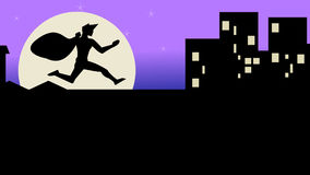 A thief running a cross rooftops Royalty Free Stock Images
