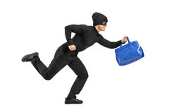 Thief running with a stolen purse. Full length portrait of a thief running with a stolen purse  on white background Royalty Free Stock Photos