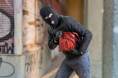 Image result for thief running with merchandise pictures