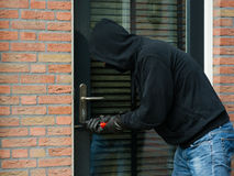 Thief with a screwdriver Royalty Free Stock Image