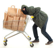 Thief with shopping cart full of papers bags Stock Images