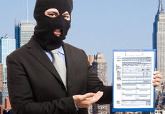Thief showing a document Royalty Free Stock Photos
