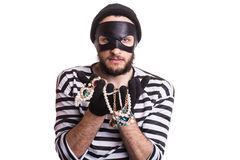 Thief showing stolen jewelry. Portrait isolated on white background Royalty Free Stock Image