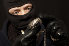 Thief with a silver bracelet Stock Photos