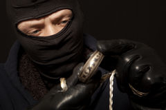 Thief with a silver bracelet Stock Image